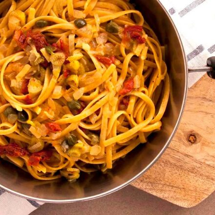 A photo of a pan with yummy linguini with fennel, caper, sun-dried tomatoes and ouzo sauce. A vegan recipe from All About Vegans.