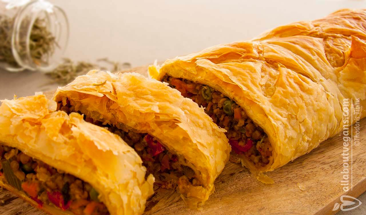 Vegan Wellington photo, sliced, with vegetables, lentils, mushrooms and aroma of cumin and rosemary. A vegan and vegetarian recipe from All About Vegans.
